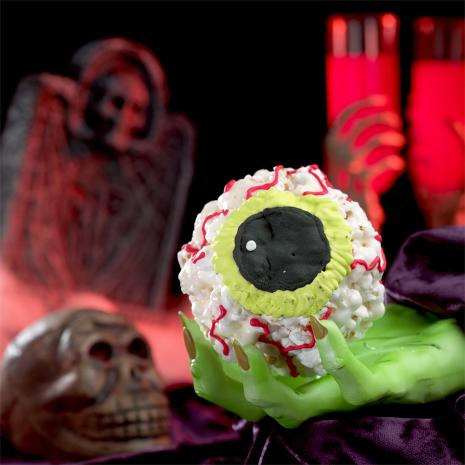 Ghoulishly Fun Halloween Popcorn Balls Recipe