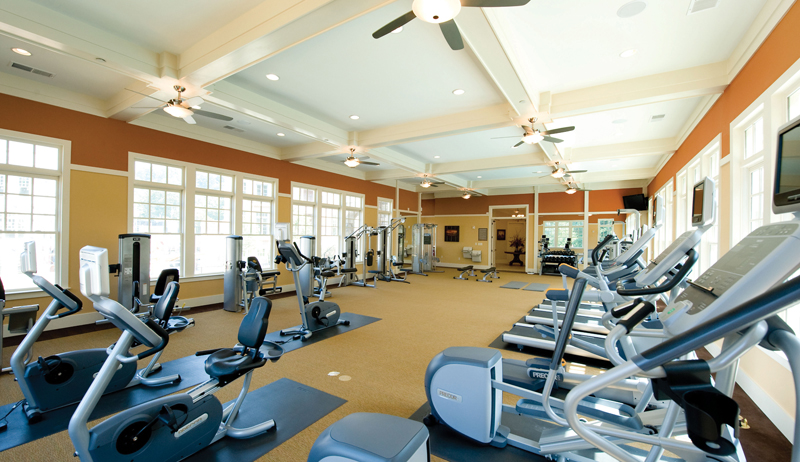 Bright sun filled fitness center with state of the art equipment at One River Place